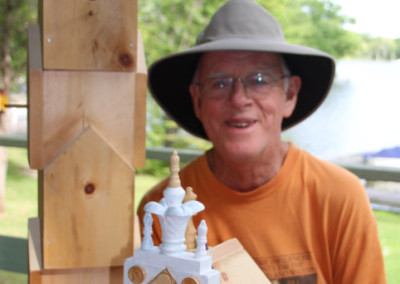 Greame with birdhouses under construction