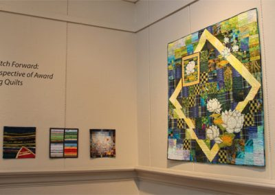 Best Stitch Forward, Homer Watson Gallery, 2018 (quilts on left and right by Millie Cumming)