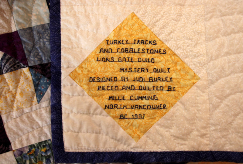 Label on Turkey Tracks and Cobblestones quilt