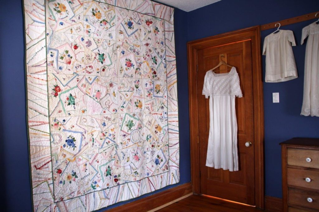 Remember Me Quilt made by Millie Cumming hanging on the wall